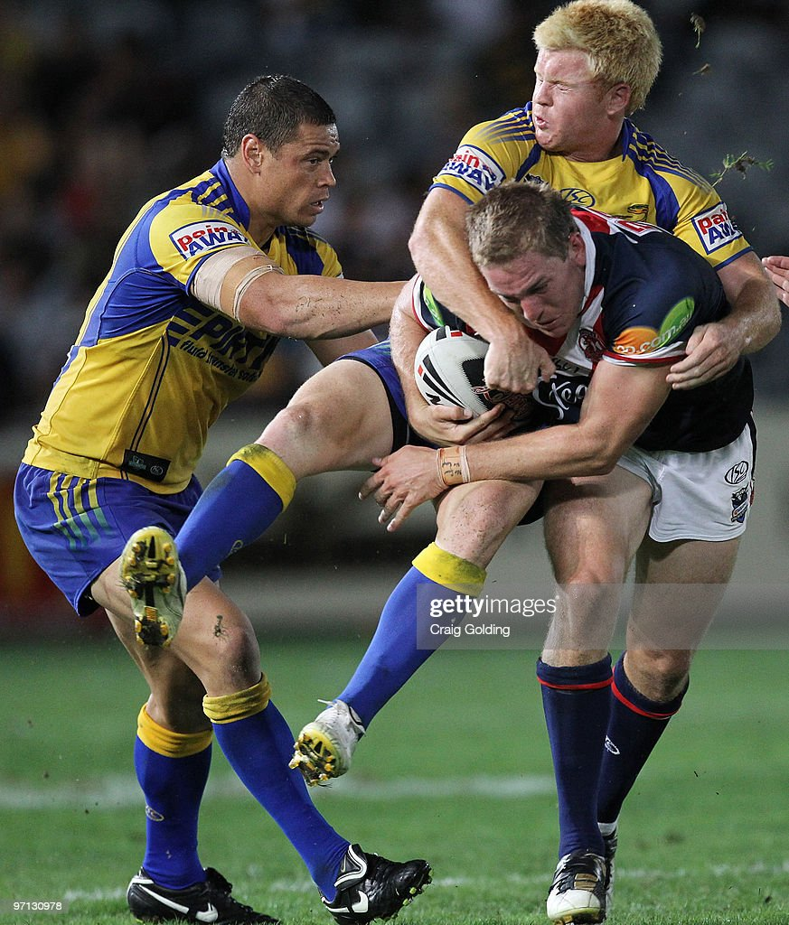 Mitchell Aubusson of the Roosters is tackled Kris Keating of the Eels during the NRL trial match between the Sydney Roosters and the Parramatta Eels at Bluetongue Stadium on February 27, 2010 in Gosford, Australia.