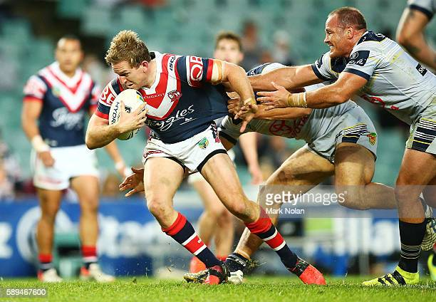 Mitchell Aubusson of the Roosters makes a line break during the round 23 NRL match between the Sydney Roosters and the North Queensland Cowboys at...