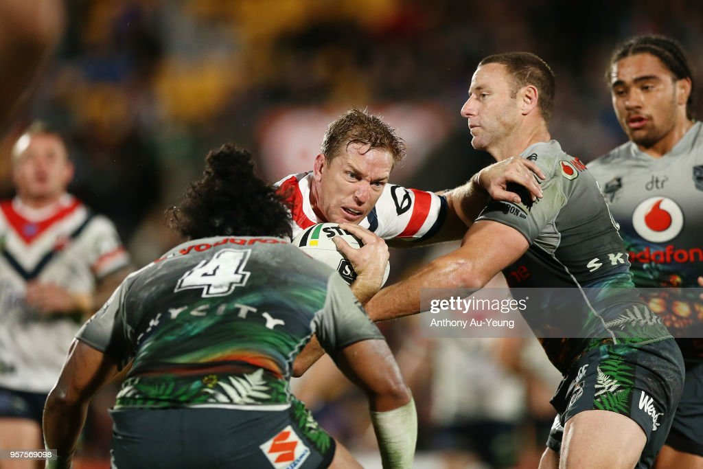 Mitchell Aubusson of the Roosters on the charge against Blake Green of the Warriors during the round 10 NRL match between the New Zealand Warriors and the Sydney Roosters at Mt Smart Stadium on May 12, 2018 in Auckland, New Zealand.