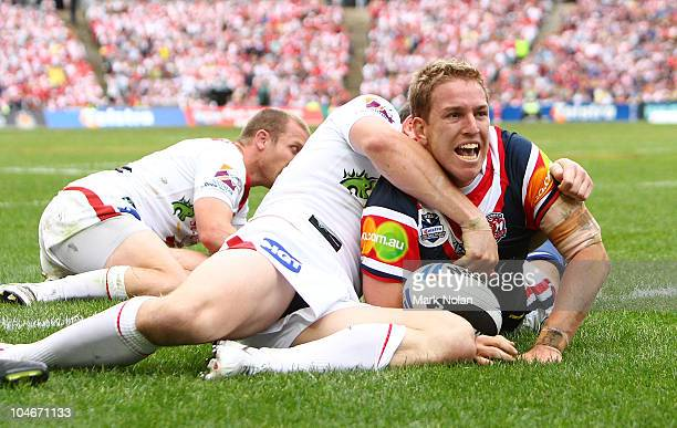 Mitchell Aubusson of the Roosters scores a try during the NRL Grand Final match between the St George Illawarra Dragons and the Sydney Roosters at...