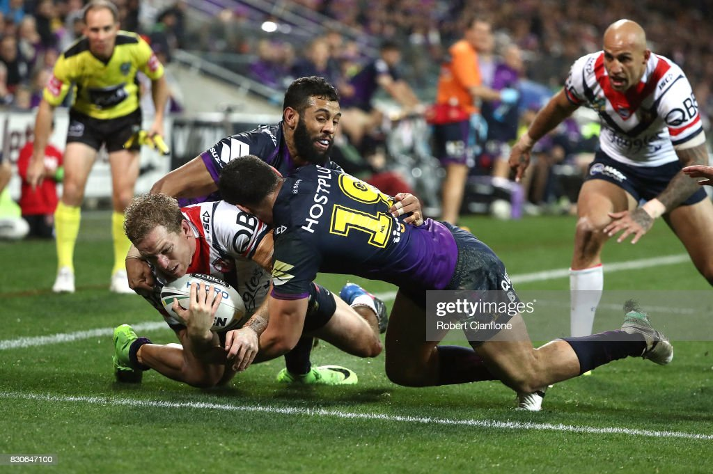 Mitchell Aubusson of the Roosters scores a try during the round 23 NRL match between the Melbourne Storm and the Sydney Roosters at AAMI Park on August 12, 2017 in Melbourne, Australia.