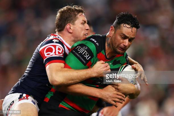 Mitchell Aubusson of the Roosters tackles John Sutton of the Rabbitohs during the NRL Preliminary Final match between the Sydney Roosters and the...
