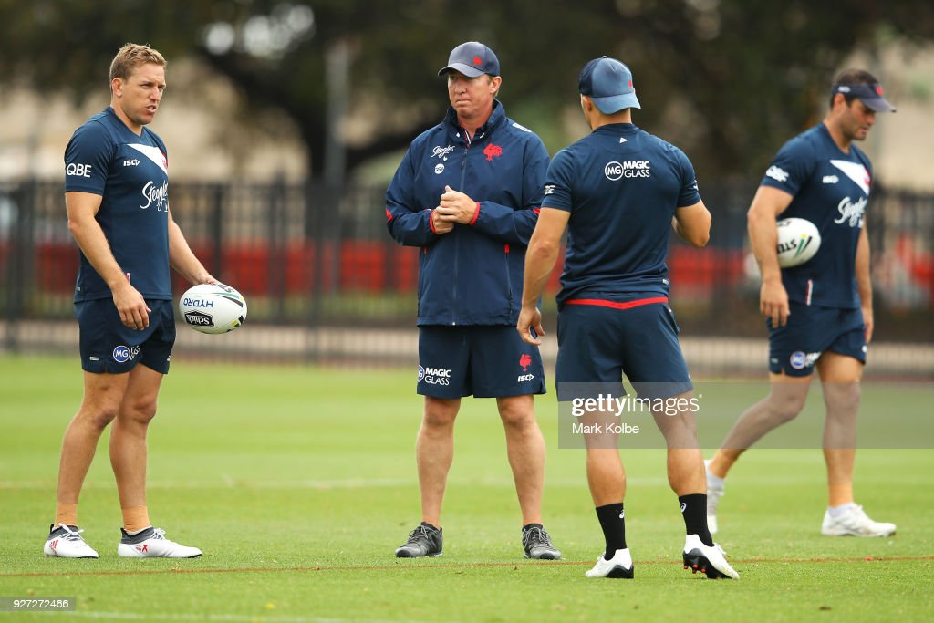 Mitchell Aubusson, Roosters coach Trent Robinson and Cooper Cronk speak during a Sydney Roosters NRL training session at Kippax Lake on March 5, 2018 in Sydney, Australia.