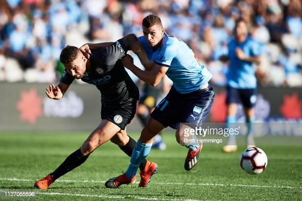 Mitchell Austin of Sydney and Bart Schenkeveld of Melbourne City contest the ball during the round 17 ALeague match between Sydney FC and Melbourne...