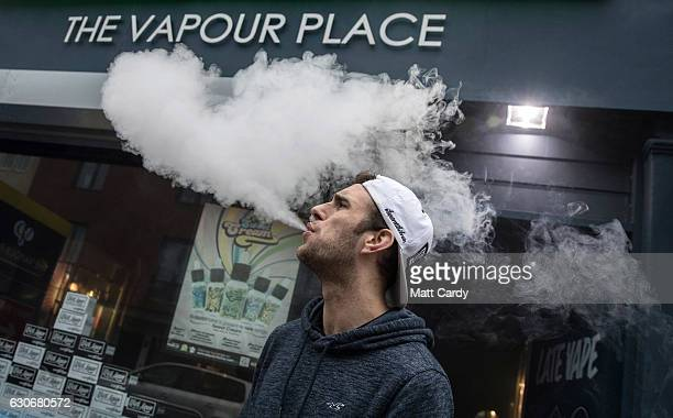 Mitchell Baker who works at the Vapour Place a vaping shop in Bedminster exhales vapour produced by an ecigarette on December 30 2016 in Bristol...