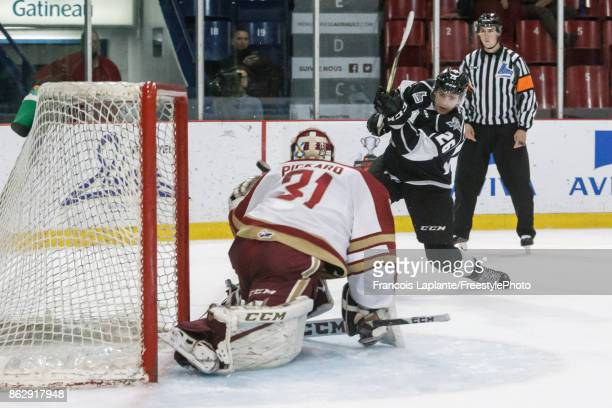Mitchell Balmas of the Gatineau Olympiques puts the puck past Reilly Pickard of the Acadie-Bathurst Titan on October 18, 2017 at Robert Guertin Arena...