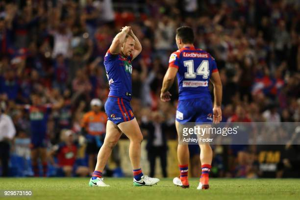 Mitchell Barnett of the Knights reacts to a missed field goal during golden point during the round one NRL match between the Newcastle Knights and...
