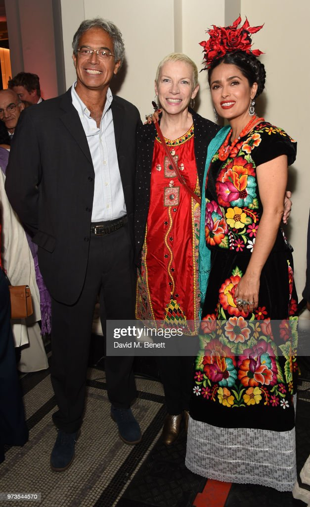 Mitchell Besser, Annie Lennox and Salma Hayek attends a private view of 'Frida Kahlo: Making Her Self Up' at The V&A on June 13, 2018 in London, England.