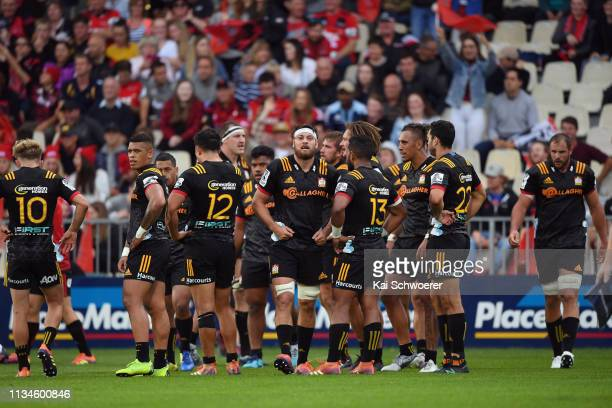 Mitchell Brown of the Chiefs and his team mates look dejected after conceding a try during the round four Super Rugby match between the Crusaders and...