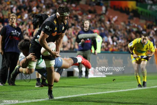 Mitchell Brown of the Chiefs is tackled by Caleb Clarke of the Bluesduring the round 5 Super Rugby Aotearoa match between the Chiefs and the Blues at...