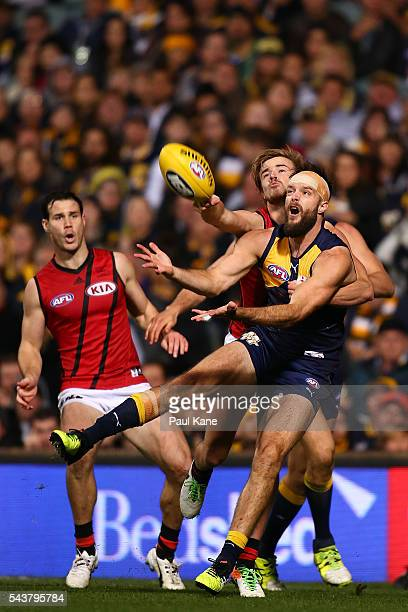 Mitchell Brown of the Eagles juggles a mark against Martin Gleeson of the Bombers during the round 15 AFL match between the West Coast Eagles and the...