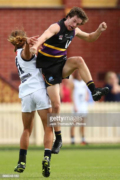 Mitchell Chafer of the Geelong Falcons and Ryan Bruce of the Murray Bushrangers compete for the ball during the round three TAC Cup match between the...