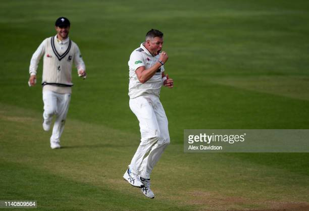 Mitchell Claydon of Kent celebrates taking the wicket of Josh Davey during Day 2 of the Specsavers County Championship match between Somerset and...