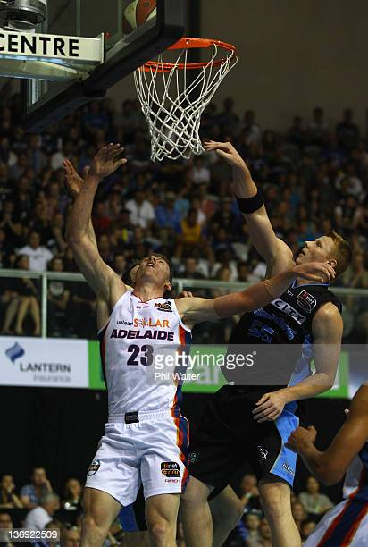 Mitchell Creek of the 36ers and Gary Wilkinson of the Breakers compete for the ball during the round 15 NBL match between the New Zealand Breakers...