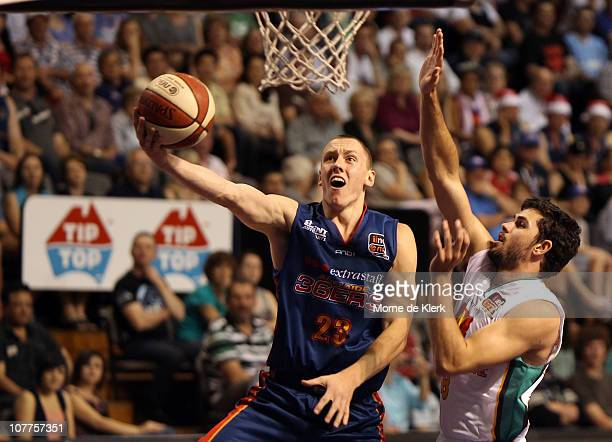 Mitchell Creek of the 36ers scores 2 points under pressure from Todd Blanchfield of the Crocodiles during the round 11 NBL match between the Adelaide...