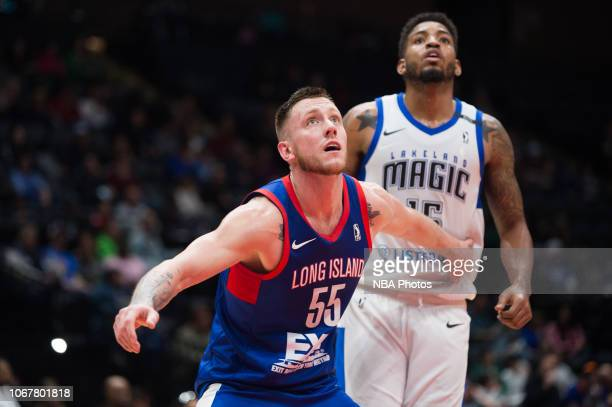 Mitchell Creek of the Long Island Nets guards Devin Davis of the Lakeland Magic during an NBA G League game on December 2, 2018 at NYCB Live, Home of...