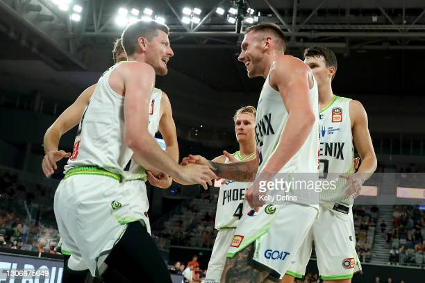 Mitchell Creek of the Phoenix and Cameron Gliddon of the Phoenix react during the NBL Cup match between the Cairns Taipans and the South East...