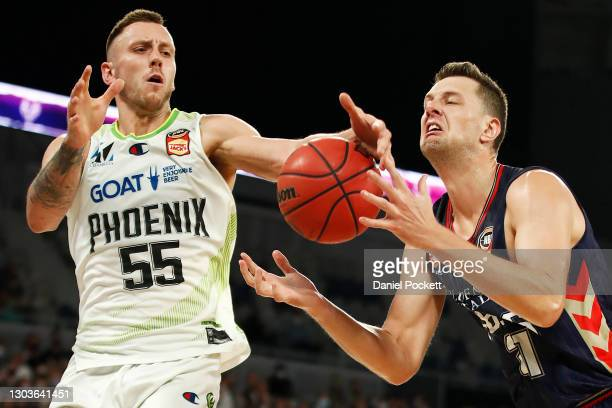 Mitchell Creek of the Phoenix and Daniel Johnson of the 36ers contest the ball during the NBL Cup match between the Adelaide 36ers and the South East...