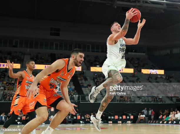 Mitchell Creek of the Phoenix drives to the basket during the NBL Cup match between the Cairns Taipans and the South East Melbourne Phoenix at John...
