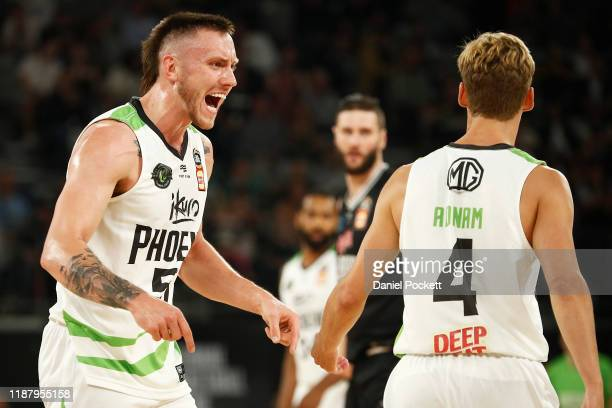 Mitchell Creek of the Phoenix gestures to Kyle Adnam of the Phoenix during the round seven NBL match between Melbourne United and the South East...