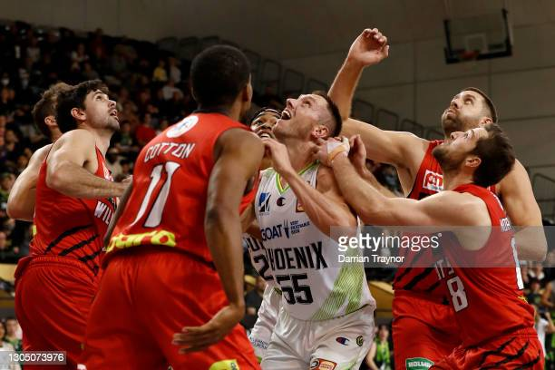 Mitchell Creek of the Phoenix is surrounded by Wildcats players attempting to rebounds the ball during the NBL Cup match between the Perth Wildcats...