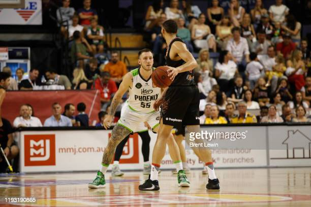 Mitchell Creek of the Phoenix, left, guards Darlington Hobson of the Hawks during the round 15 NBL match between the Illawarra Hawks and the South...