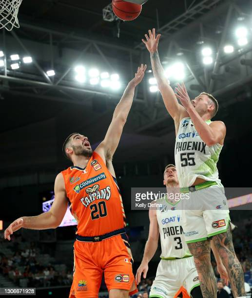 Mitchell Creek of the Phoenix shoots as Fabijan Krslovic of the Taipans defends during the NBL Cup match between the Cairns Taipans and the South...