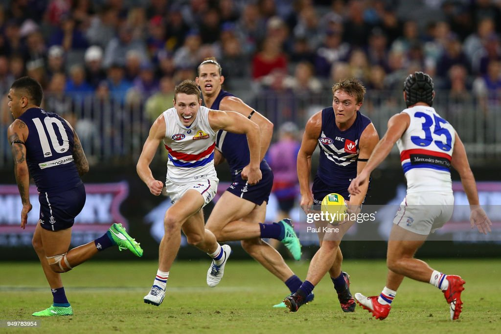 Mitchell Crowden looks to handball during the round five AFL match between the Fremantle Dockers and the Western Bulldogs at Optus Stadium on April 21, 2018 in Perth, Australia.