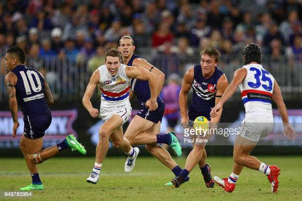 Mitchell Crowden looks to handball during the round five AFL match between the Fremantle Dockers and the Western Bulldogs at Optus Stadium on April...