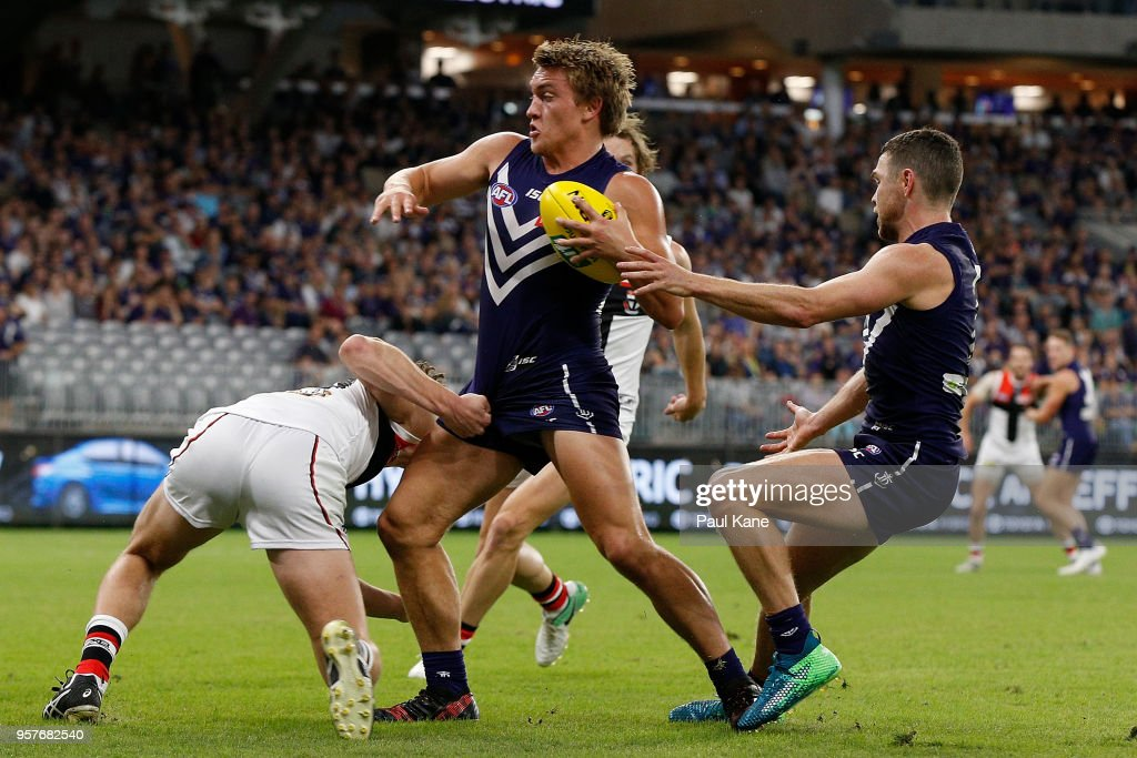 Mitchell Crowden of the Dockers looks to break from a tackle by Nick Coffield of the Saints during the round eight AFL match between the Fremantle Dockers and the St Kilda Saints at Optus Stadium on May 12, 2018 in Perth, Australia.