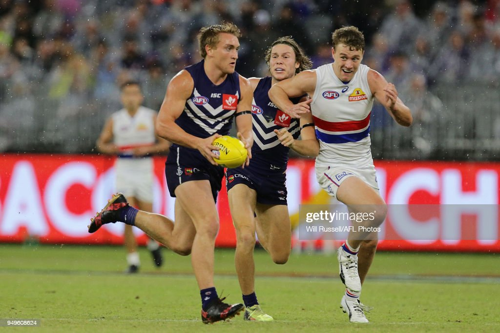 Mitchell Crowden of the Dockers looks to pass the ball during the round five AFL match between the Fremantle Dockers and the Western Bulldogs at Optus Stadium on April 21, 2018 in Perth, Australia.