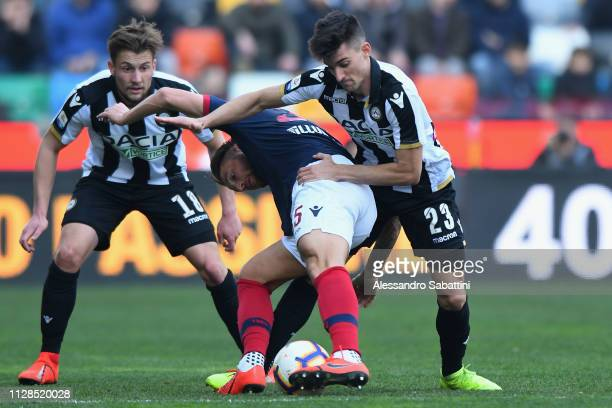 Mitchell Dijks of Bologna FC competes for the ball with Ignacio Pussetto of Udinese Calcio during the Serie A match between Udinese and Bologna FC at...