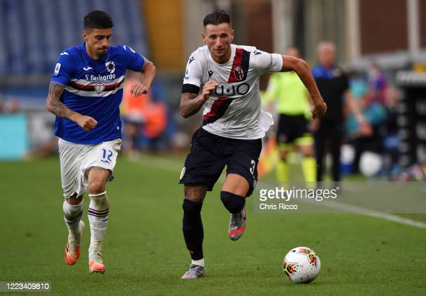 Mitchell Dijks of Bologna FC evades challenge from Fabio Depaoli of UC Sampdoria during the Serie A match between UC Sampdoria and Bologna FC at...