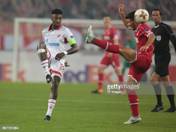 Mitchell Donald of Belgrad and Milos Jojic of Koeln battle for the ball during the UEFA Europa League group H match between 1 FC Koeln and Crvena...