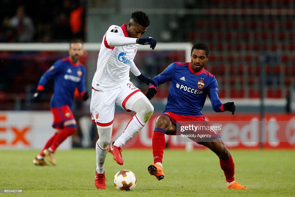 Mitchell Donald (L) of Crvena Zvezda in action against Vitinho (R) of CSKA Moscow during the UEFA Europa League round of 32, second leg soccer match between CSKA Moscow and Crvena Zvezda at the Stadium CSKA Moscow in Moscow, Russia on February 21, 2018.