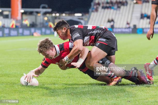 Mitchell Drummond of Canterbury dives over to score a try during the round 8 Mitre 10 Cup match between Canterbury and Counties Manukau at...
