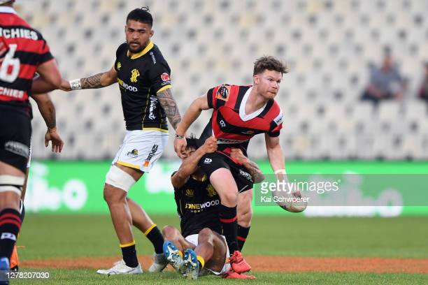 Mitchell Drummond of Canterbury offloads the ball during the round 4 Mitre 10 Cup match between Canterbury and Wellington at Orangetheory Stadium on...