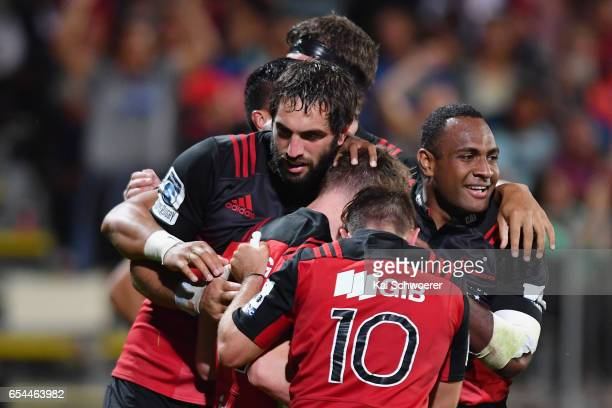 Mitchell Drummond of the Crusaders and his teammates celebrate scoring a try during the round four Super Rugby match between the Crusaders and the...
