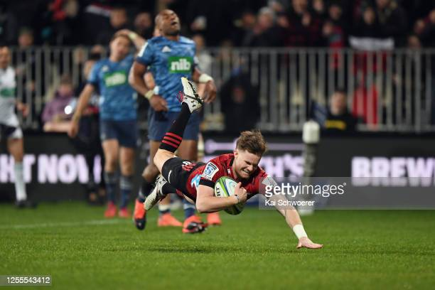 Mitchell Drummond of the Crusaders dives over to score a try during the round 5 Super Rugby Aotearoa match between the Crusaders and the Blues at...