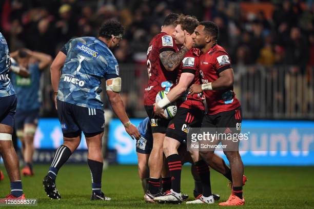 Mitchell Drummond of the Crusaders is congratulated by team mates after scoring a try during the round 5 Super Rugby Aotearoa match between the...
