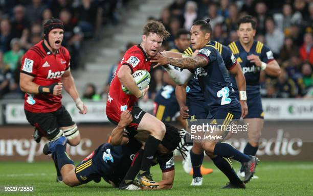 Mitchell Drummond of the Crusaders looks to offload during the round five Super Rugby match between the Highlanders and the Crusaders at Forsyth Barr...