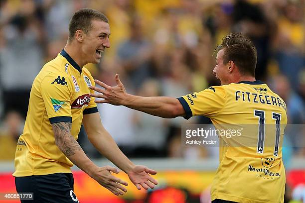 Mitchell Duke and Nick Fitzgerald of the Mariners celebrate a goal during the round 13 A-League match between the Central Coast Mariners and the...