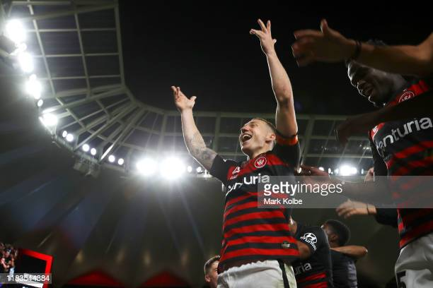 Mitchell Duke and the Wanderers players celebrate with the crowd after victory during the round three A-League match between the Western Sydney...