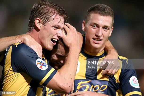 Mitchell Duke Nick Fitzgerald celebrate Marcel Seip's goal during the Asian Champions League match between the Central Coast Mariners and Beijing...