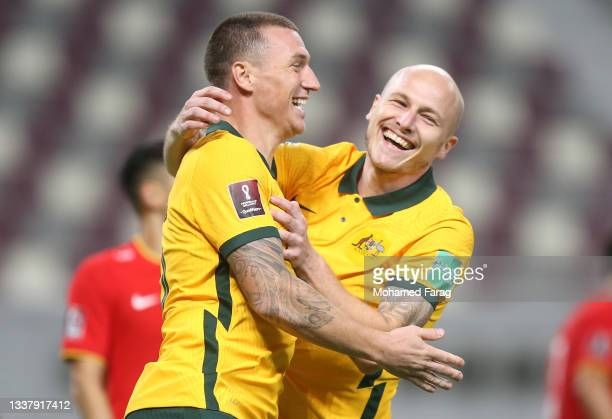 Mitchell Duke of Australia celebrates after scoring their team's third goal during the 2022 FIFA World Cup Qualifier match between Australia and...