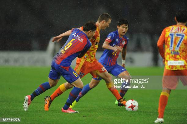 Mitchell Duke of Shimizu SPulse and Kosuke Ota of FC Tokyo compete for the ball during the JLeague J1 match between FC Tokyo and Shimizu SPulse at...