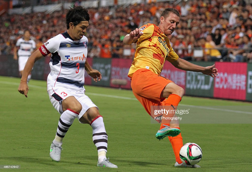 Mitchell Duke of Shimizu S-Pulse and Masato Morishige of FC Tokyo compete for the ball during the J.League match between Shimizu S-Pulse and FC Tokyo at IAI Stadium Nihondaira on August 29, 2015 in Shizuoka, Japan.