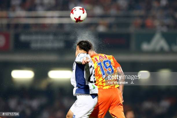 Mitchell Duke of Shimizu SPulse and Oh Jae Suk of Gamba Osaka compete for the ball during the JLeague J1 match between Shimizu SPulse and Gamba Osaka...