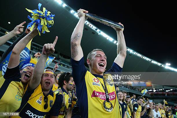 Mitchell Duke of the Mariners celebrates with the trophy after winning the ALeague 2013 Grand Final match between the Western Sydney Wanderers and...