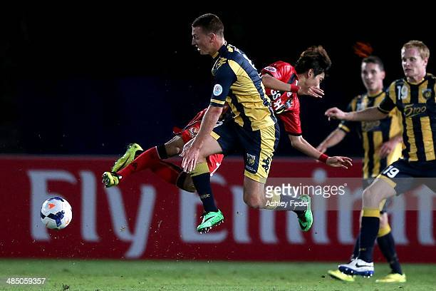Mitchell Duke of the Mariners in the air with FC Seoul defence in frame during the AFC Asian Champions League match between the Central Coast...